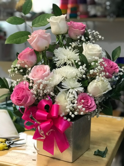 1.) Pink and White Roses with Cushion flowers. $65.00