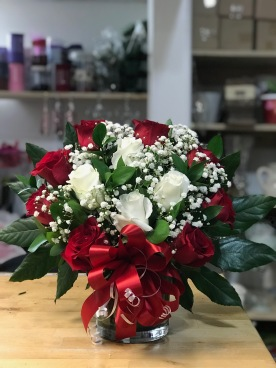 26.) Red and white roses, with baby breath.