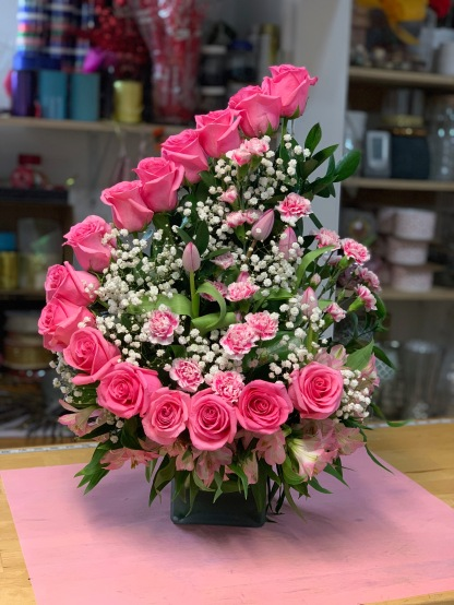 11.)Super design in pink roses, with pink mini carnations $130.00