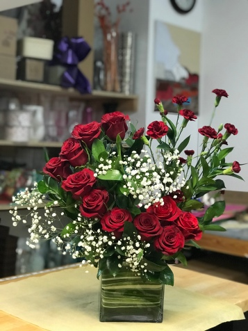 2.)Rectangular glass vase with Red roses, red mini carnation and baby breathSpecial: $110.00
