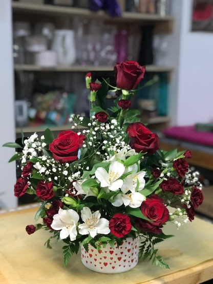 17.) Red roses,red mini carnations and white astromelias on a ceramic vase of small red heartsSpecial: $48.00