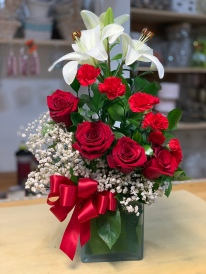 18.) Red roses, white lilies, red carnations and baby breath.Special: $64.99