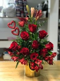 15.) Lilies, red roses, red astromelias, with a beautiful red hearts on a gold round ceramic vaseSpecial: $80