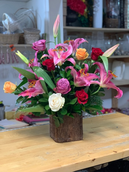 10.)Pink Lilies with mix color roses in a wood vaseSpecial: $135.00