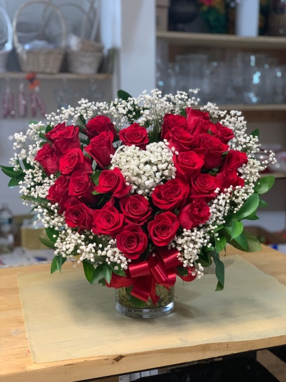 23.) Heart-shaped arrangement with red roses and baby breathSpecial: $150.00