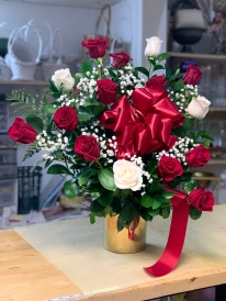 19.) A dozen red roses with four white roses, baby breath and a big red ribbon.Vases come in gold and silver.Special: $120.00