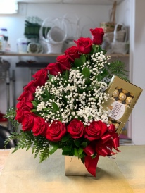 20.) A row of red roses with baby breath and a box of chocolates.Special: $135.00