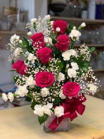 21.) Hot pink roses combined with white mini carnations and baby breathSpecial: $75.00