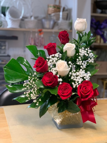 22.) Red and white roses with big green leaf and baby breathSpecial: $65.00