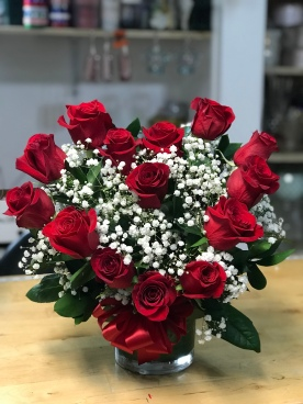 4.)Red roses heart shape with baby breathSpecial $110.00