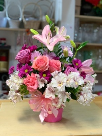 14.) Pink and Purple Roses, Pink Lillies, White Astromelia, and Purple Cushion. $75.00