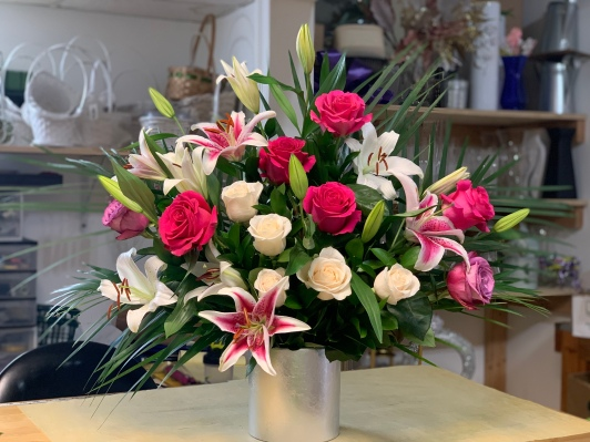 16.) Oriental and White Lillies, Pink, White and Red Roses $180.00