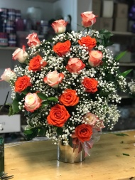 7.) Orange and White Roses with Baby Breath. $145.00